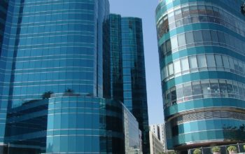 """Cladding is the """"skin"""" of a building. In recent yeas, many tall buildings have used reflective, tinted glass."""
